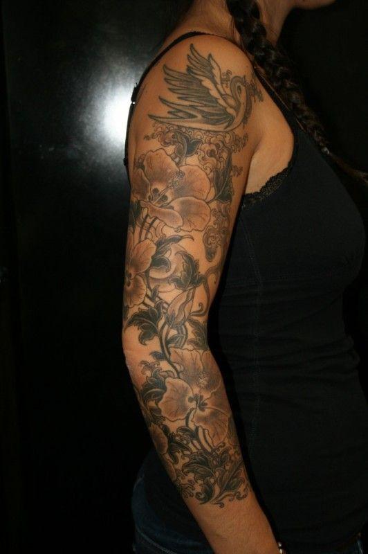 Tatouage fleur bras complet