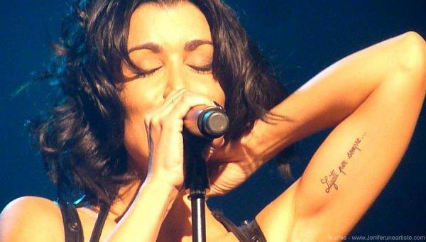 tatouage jenifer bras gauche