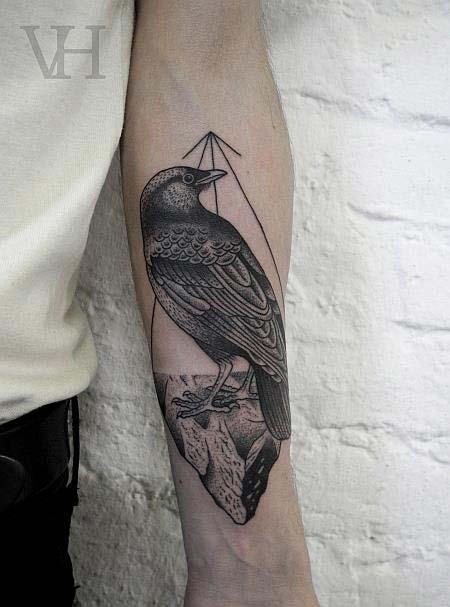 tatouage oiseau bras
