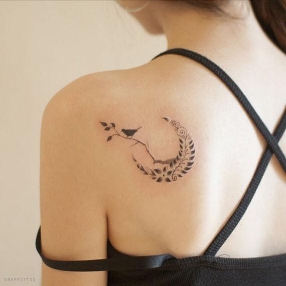 tatouage oiseau noir et blanc